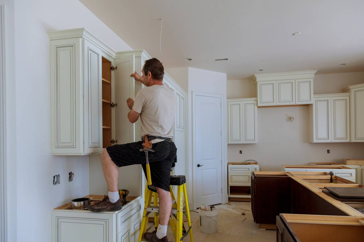 Man starting to renovate your kitchen.